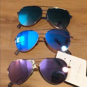 Three different colored American eagle sunglasses